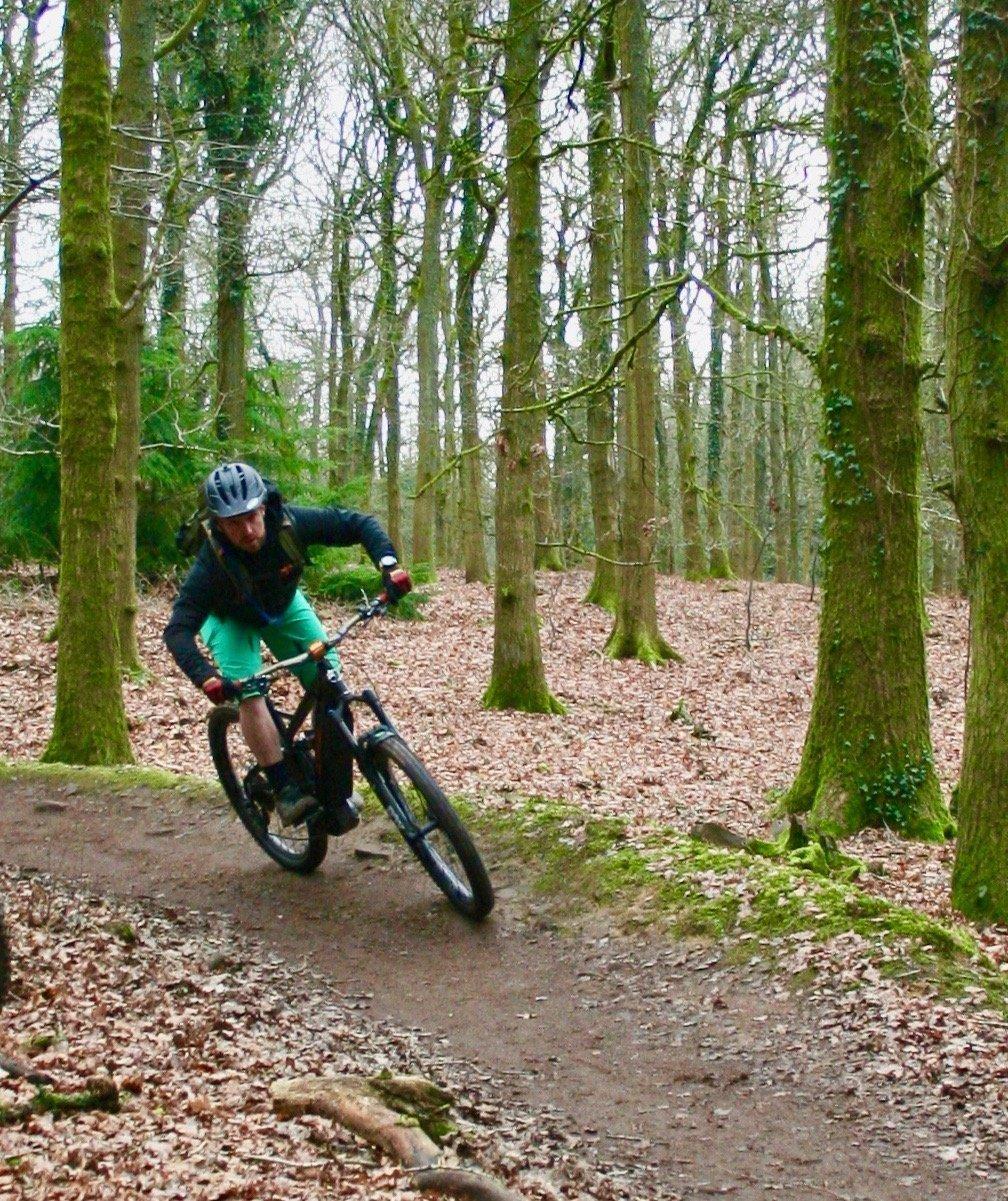 E Bike railing a berm in the Forest of Dean, pedalabikeaway
